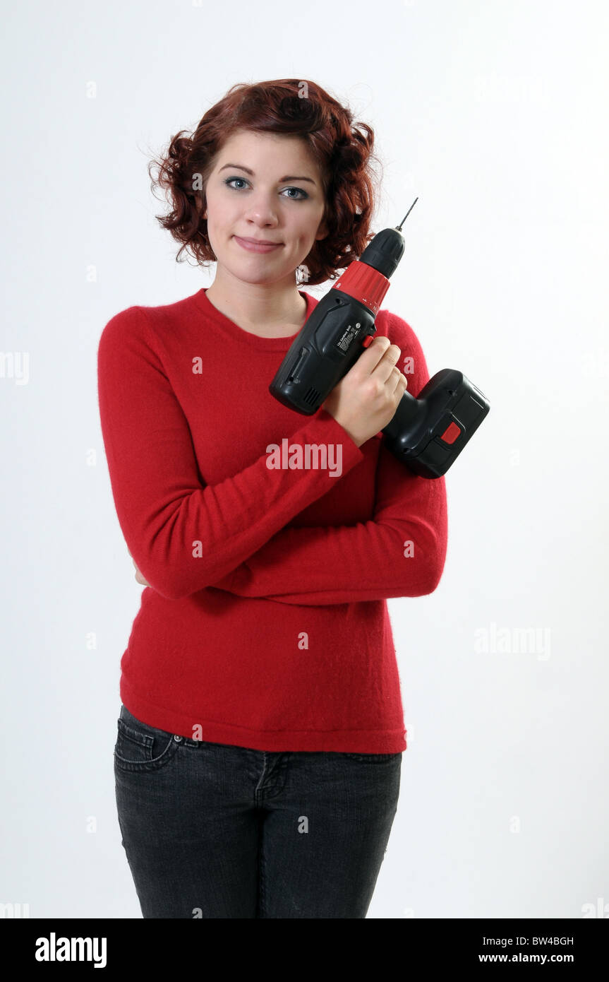 Woman holding a drill - Stock Image