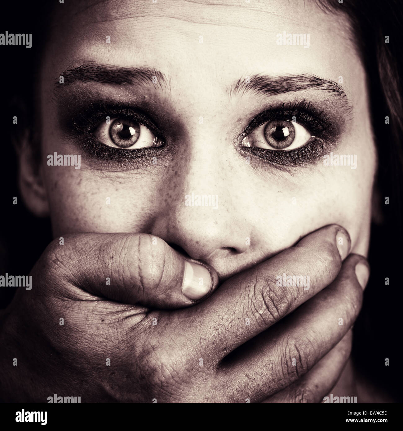 Scared woman victim of domestic torture and violence - Stock Image