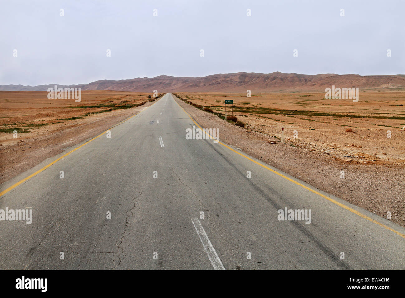 Desert road leading to Damascus in Syria. - Stock Image