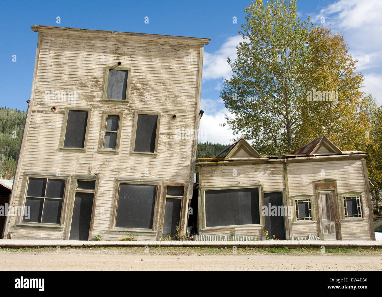Two heritage buildings in Dawson city, Yukon, slant towards each other due to melted permafrost - Stock Image