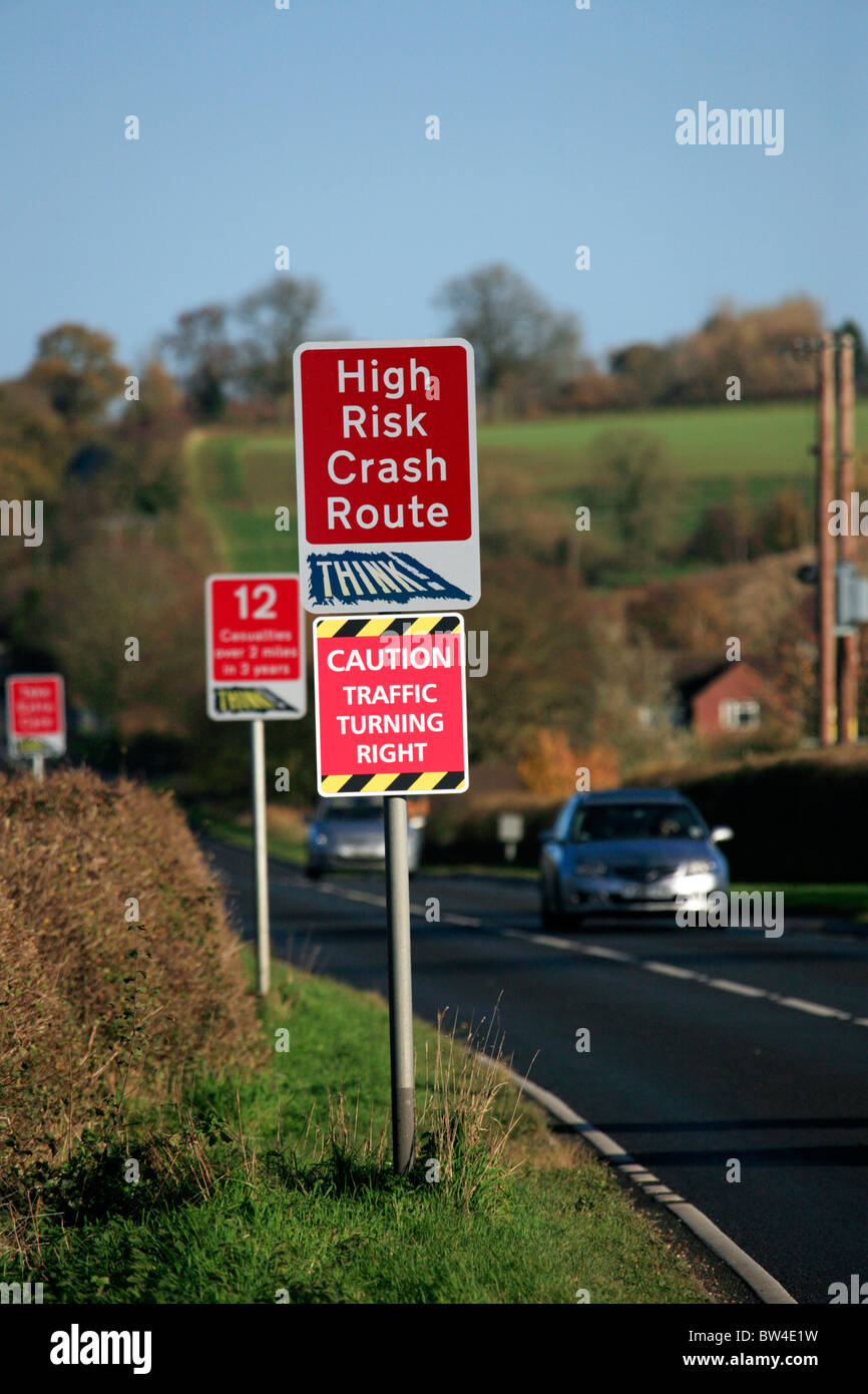 Signs Warning of High Risk Crash Route and Casualty Statistics on the Fosse Way Rural Road, Warwickshire - Stock Image