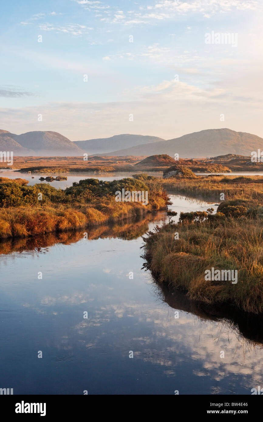 The Maumturk Mountains and the Invermore River, Connemara, County Galway, Connaught, Ireland. Stock Photo