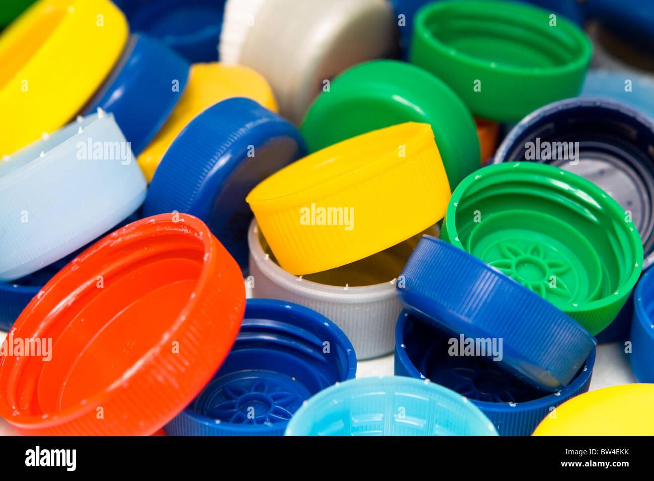 Lots of colorful plastic caps. Shot in studio. - Stock Image