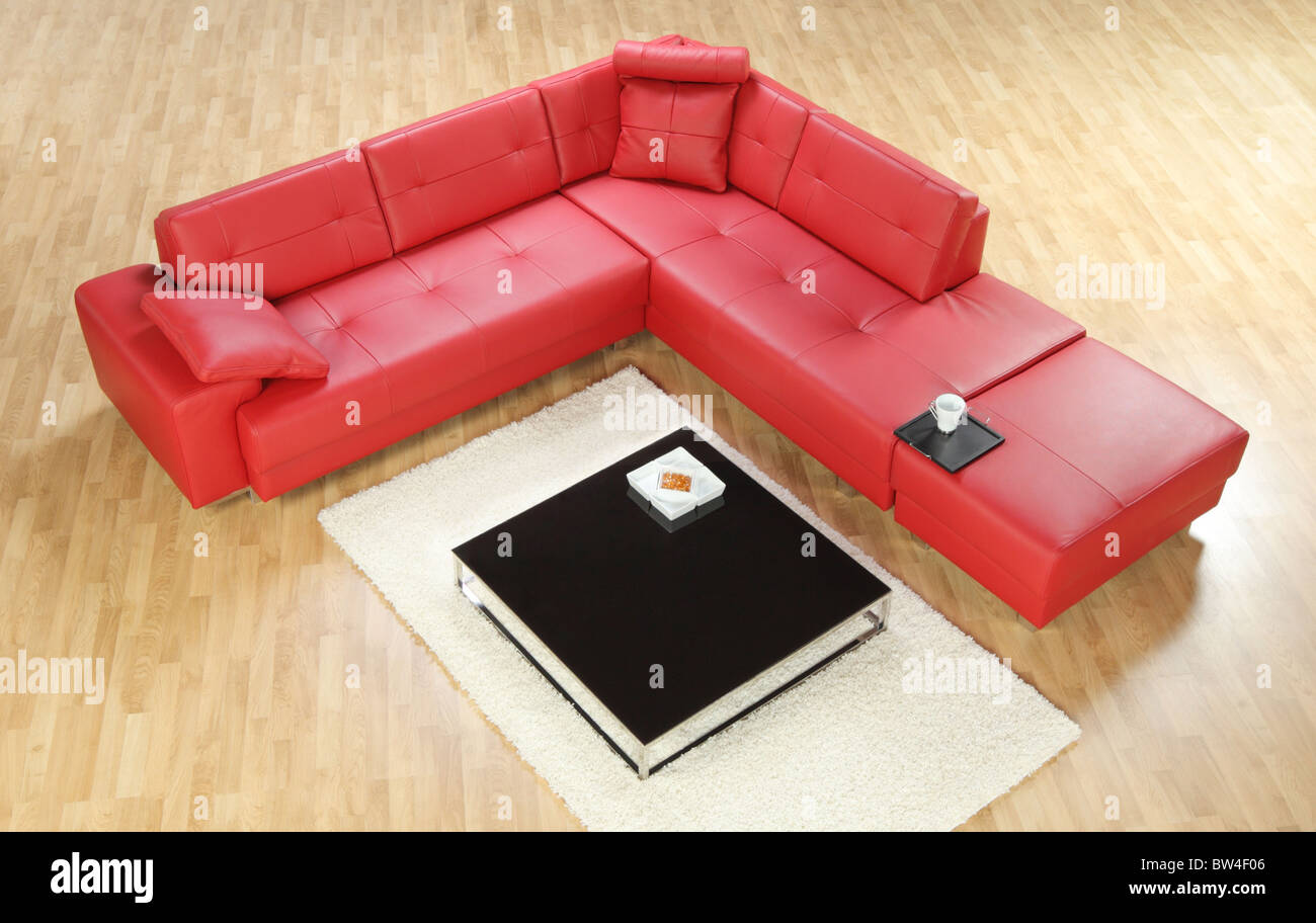 A red modern leather sofa - Stock Image