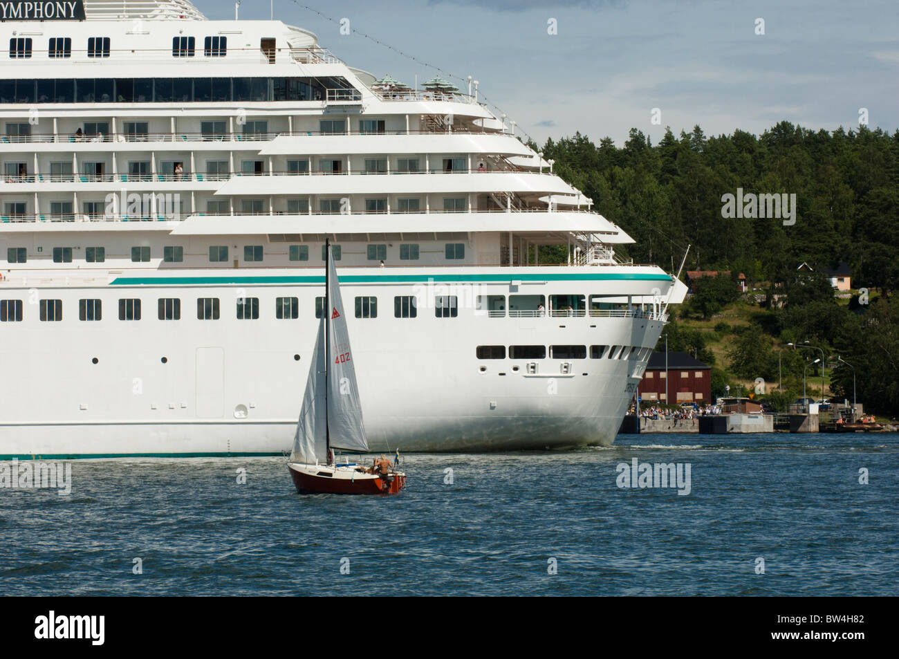 Small sailboats and large ferry Stock Photo