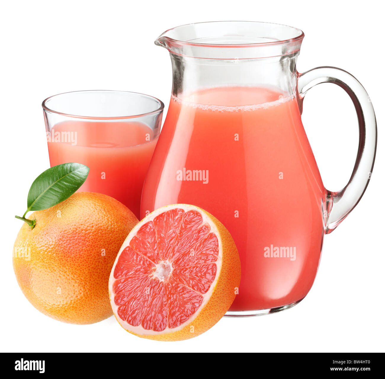 Full glass and jar of grapefruit juice and fruits in front. - Stock Image