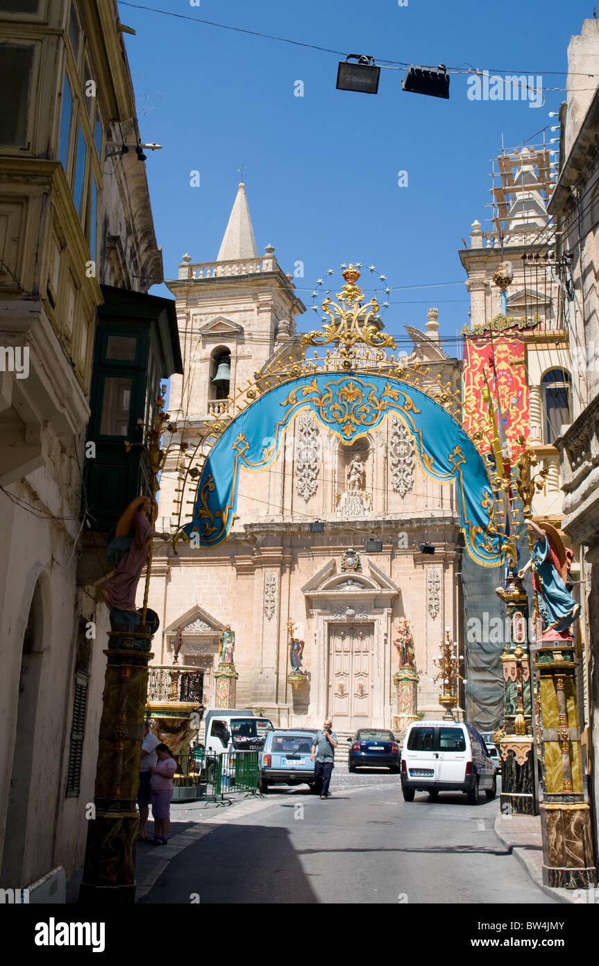 The banners and statues are out as the village of Tarxien, Malta gets ready to celebrate its festa weekend. - Stock Image