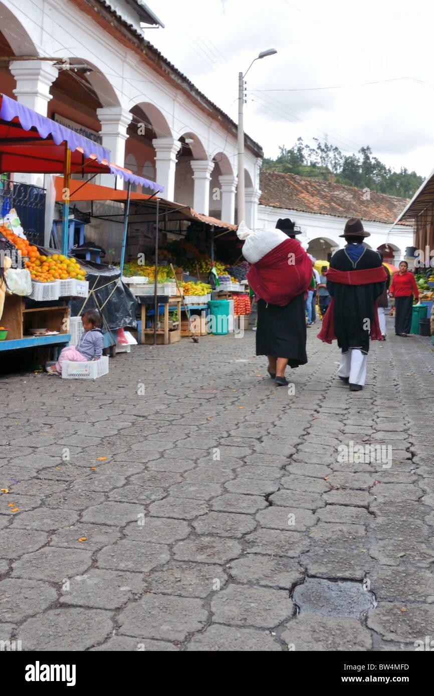 Otavalo Market - Traditional dress in the Produce Market - Stock Image