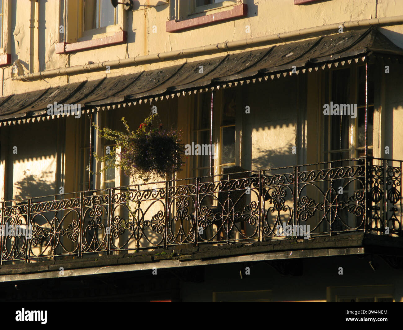 Faded grandeur of once luxury hotel in evening sunshine - Stock Image