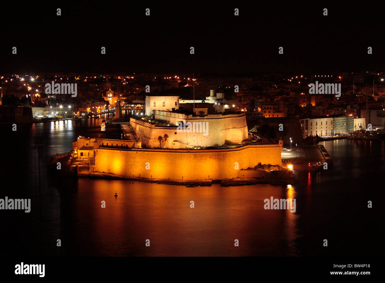 Fort St Angelo in Grand Harbour of Malta, Europe, at night. Maltese history. Historic buildings and military architecture. - Stock Image