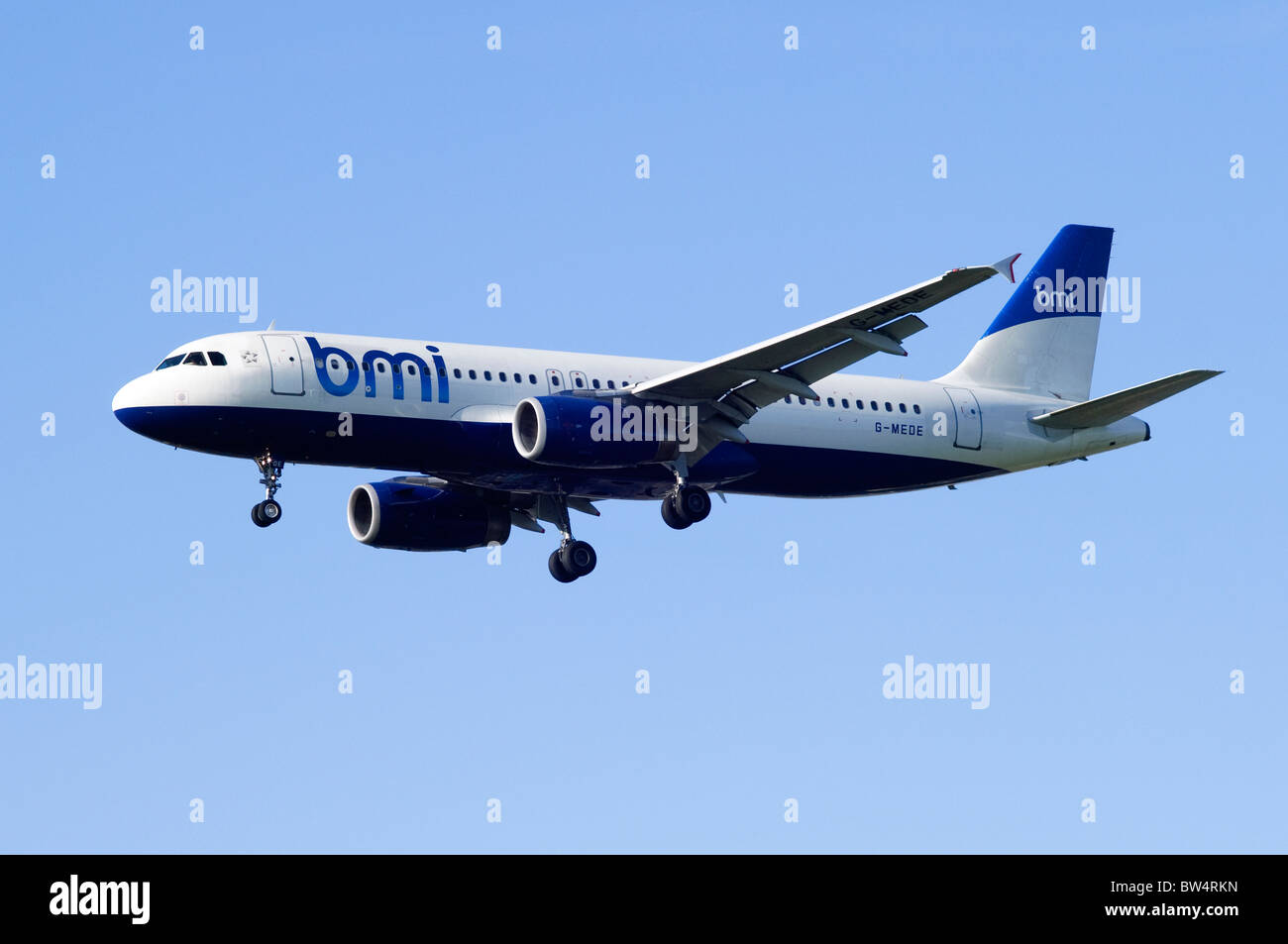 Airbus A320 operated by BMI on approach for landing at London Heathrow Airport - Stock Image