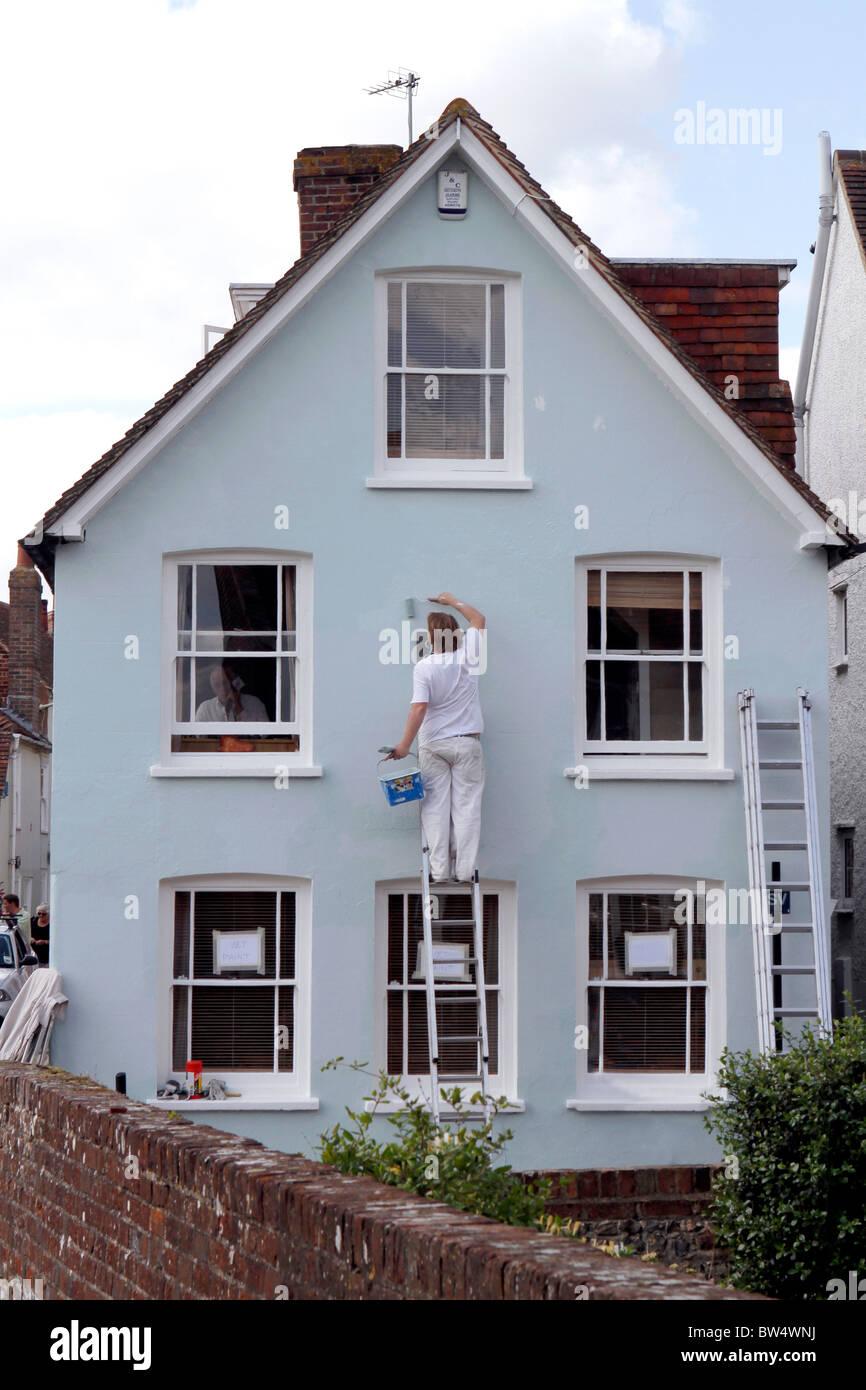 Painter in Bosham, West Sussex, Britain. - Stock Image