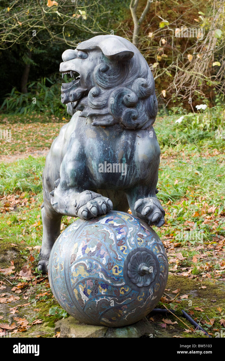 Foo Dog Sculpture on ball - Stock Image