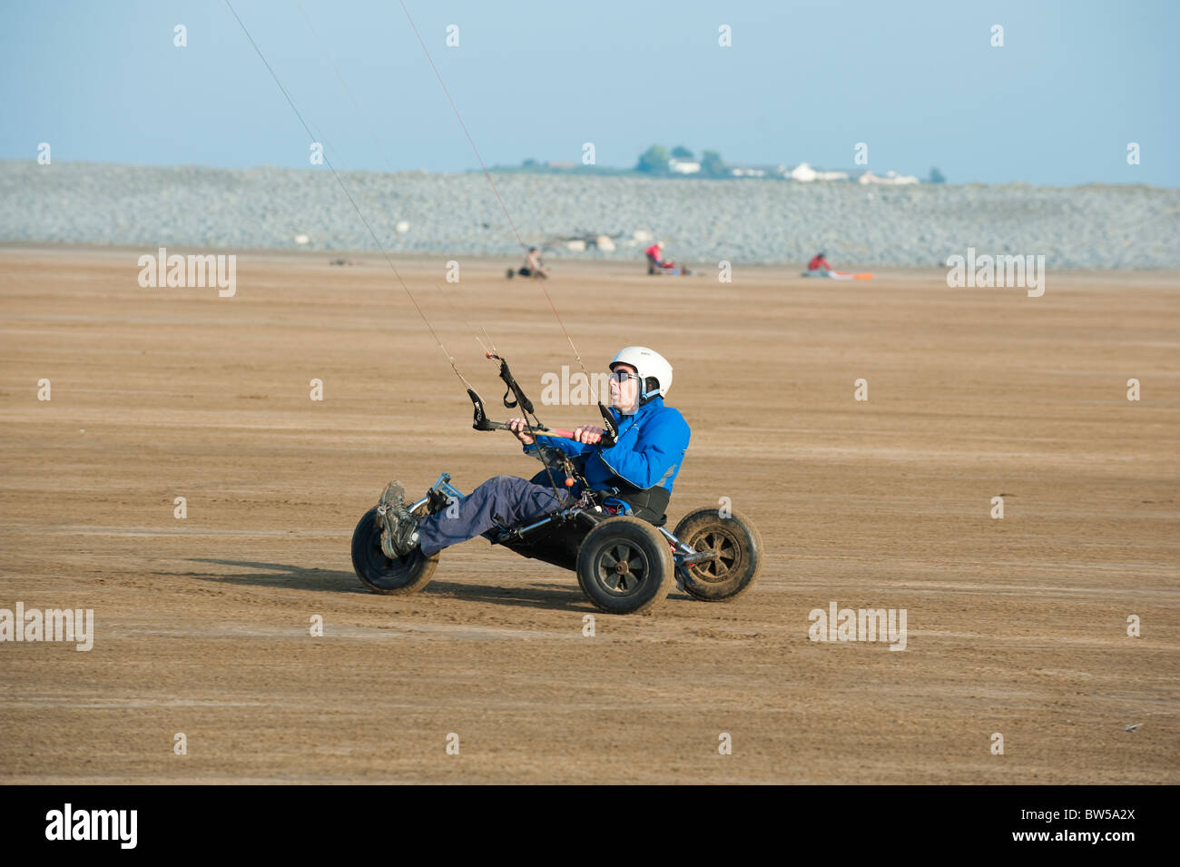 Man with kite buggy on the beach at Westward Ho! Devon UK Stock Photo