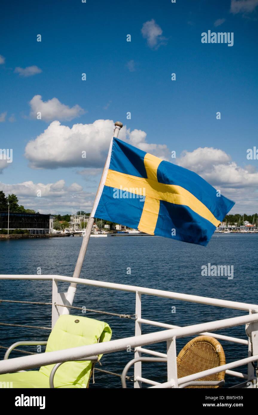 swedish flag sweden sverge flags national identity boat boating boats yacht yachts sailing sail stockholm archipelago - Stock Image