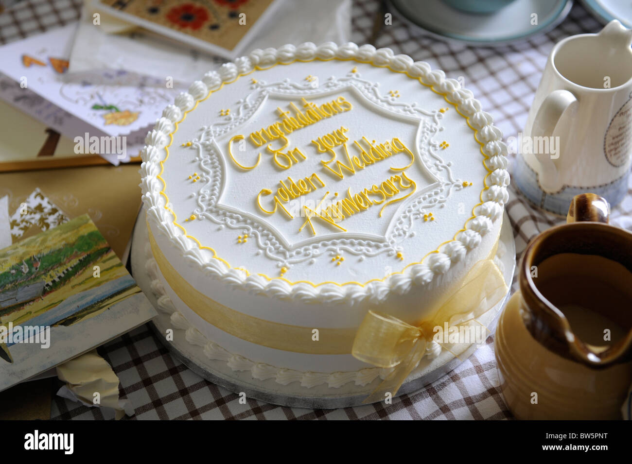 golden wedding cake to celebrate 50 years of marriage stock photo