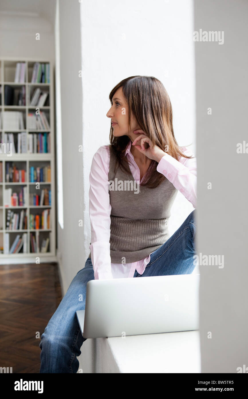 Woman looking back to someone - Stock Image