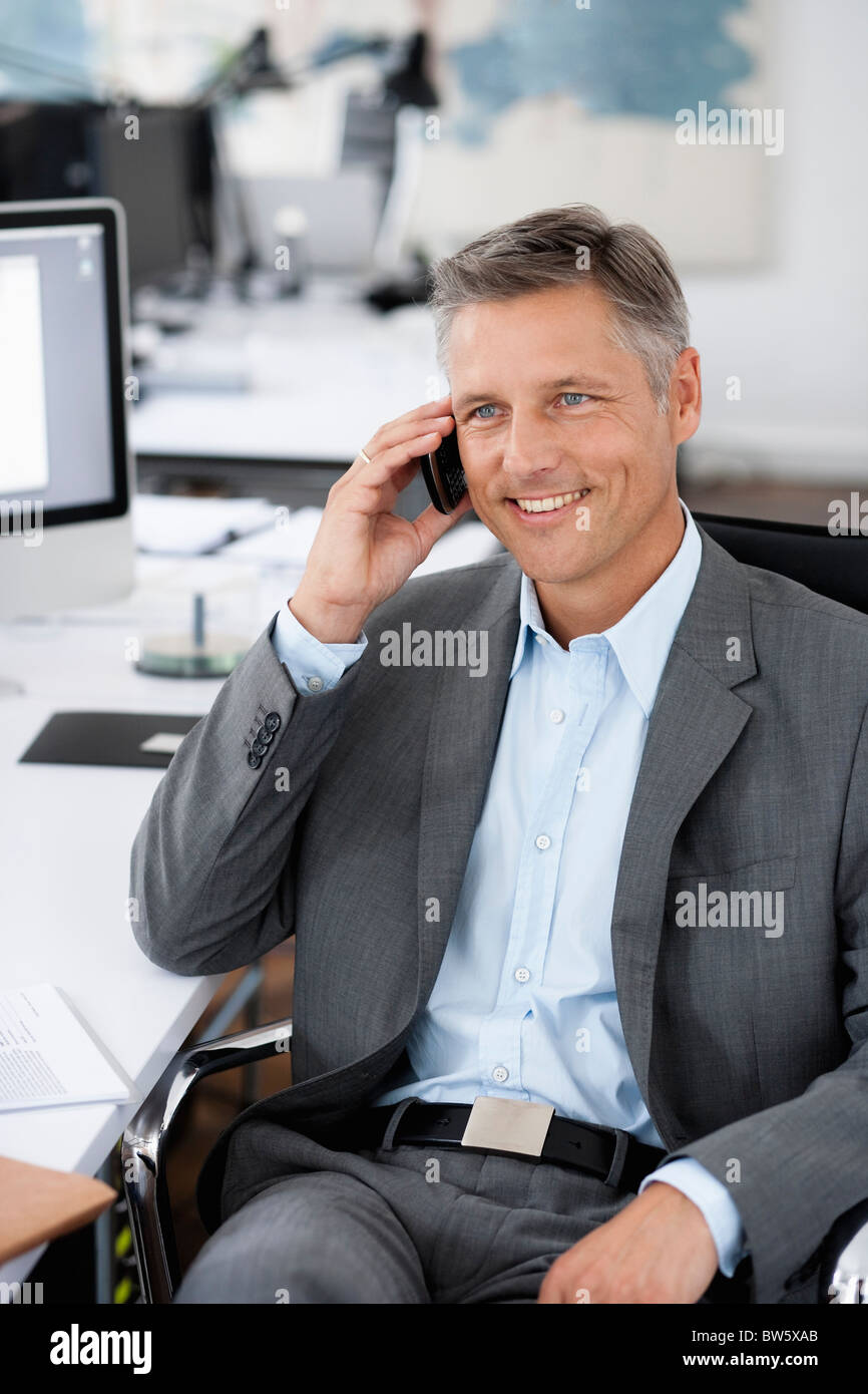Man in office phoning - Stock Image