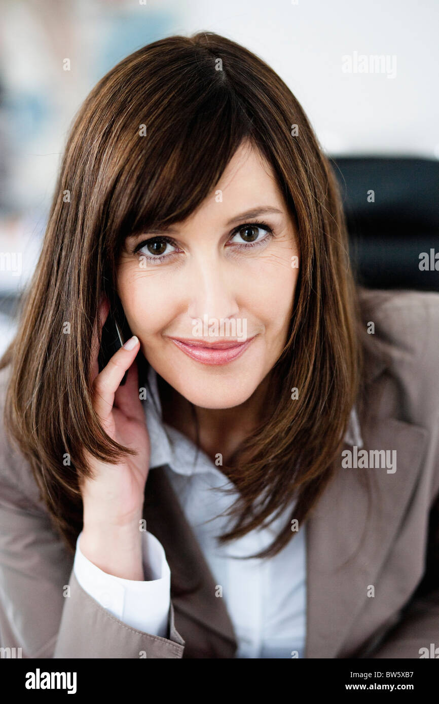Woman in suit phoning - Stock Image