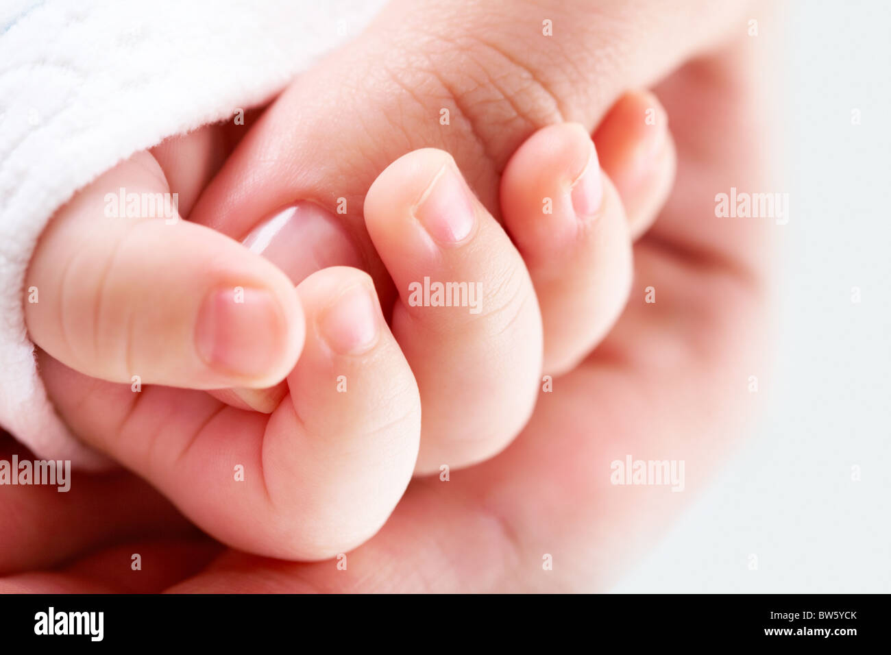 Close-up of female thumb in small hand - Stock Image