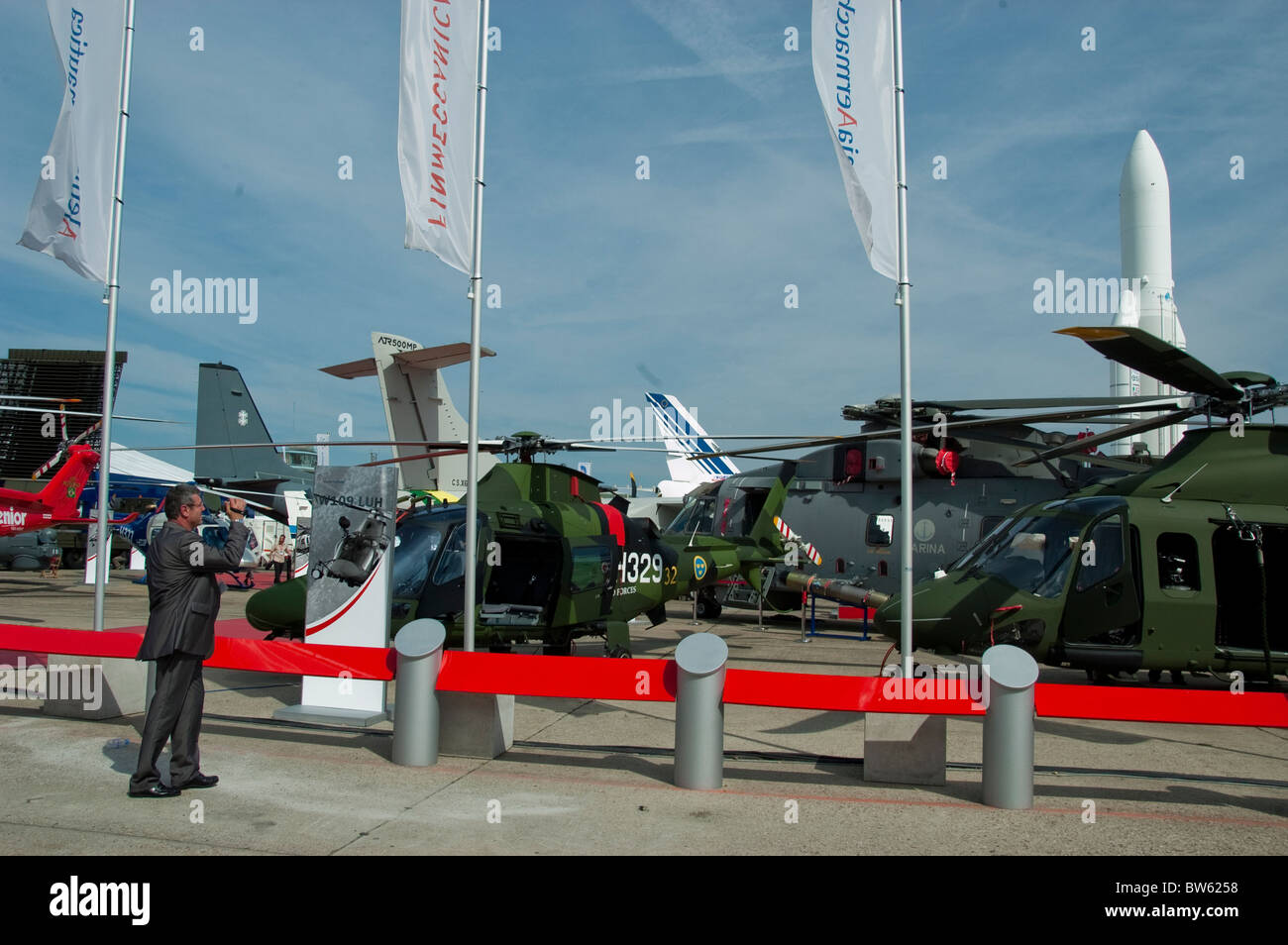 Paris, France, Trade Show, Businessmen at Paris Air Show at the Bourget Airport, Looking at Military Helicopters - Stock Image