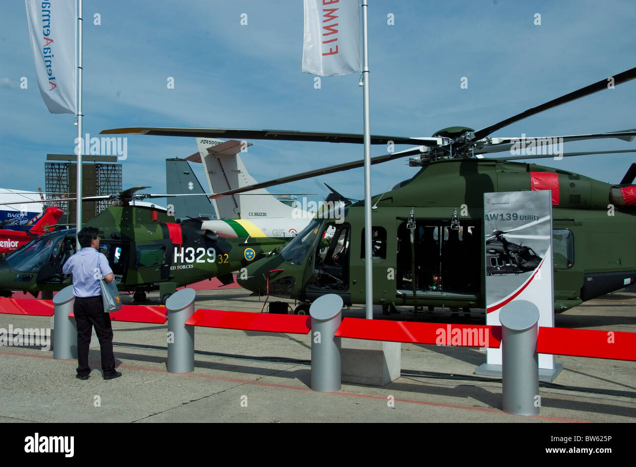 Paris, France, Trade Show, , Businessman at Paris Air Show at the Bourget Airport, Looking at Military Helicopters - Stock Image
