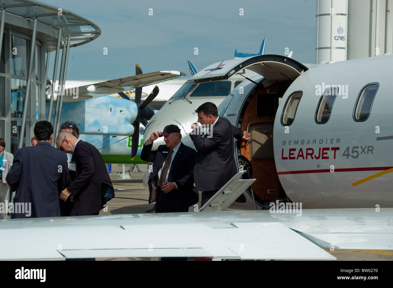 Paris, Fra-nce, Public Events, Businessmen at Paris Air Show at the Bourget Airport, Looking at Bombardier Learjet - Stock Image