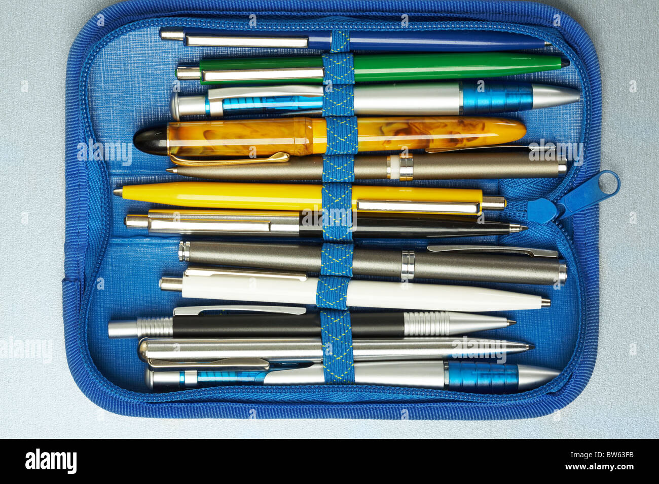 Collection of different pens placed in a blue pen-box Stock Photo