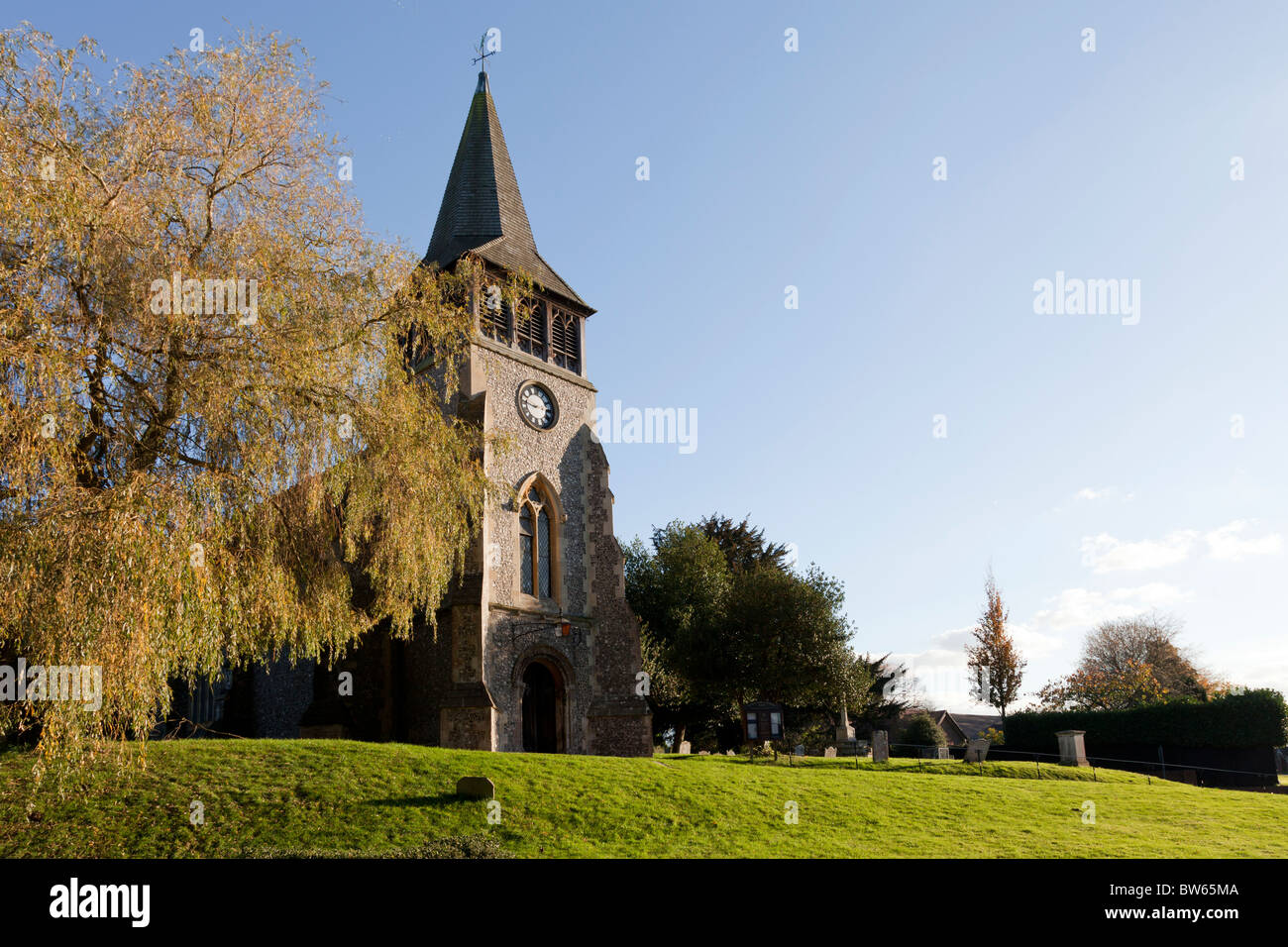 The Parish Church of St Nicholas, Wickham Village church on a hill with shingle spire - Stock Image