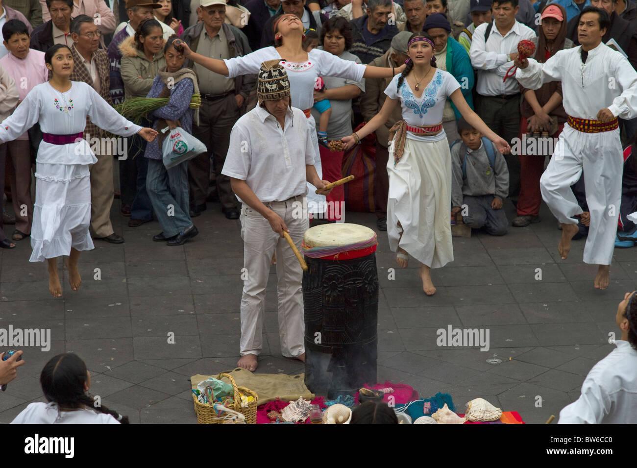 Indigenous people dancing in Plaza Grande, Quito, Ecuador - Stock Image