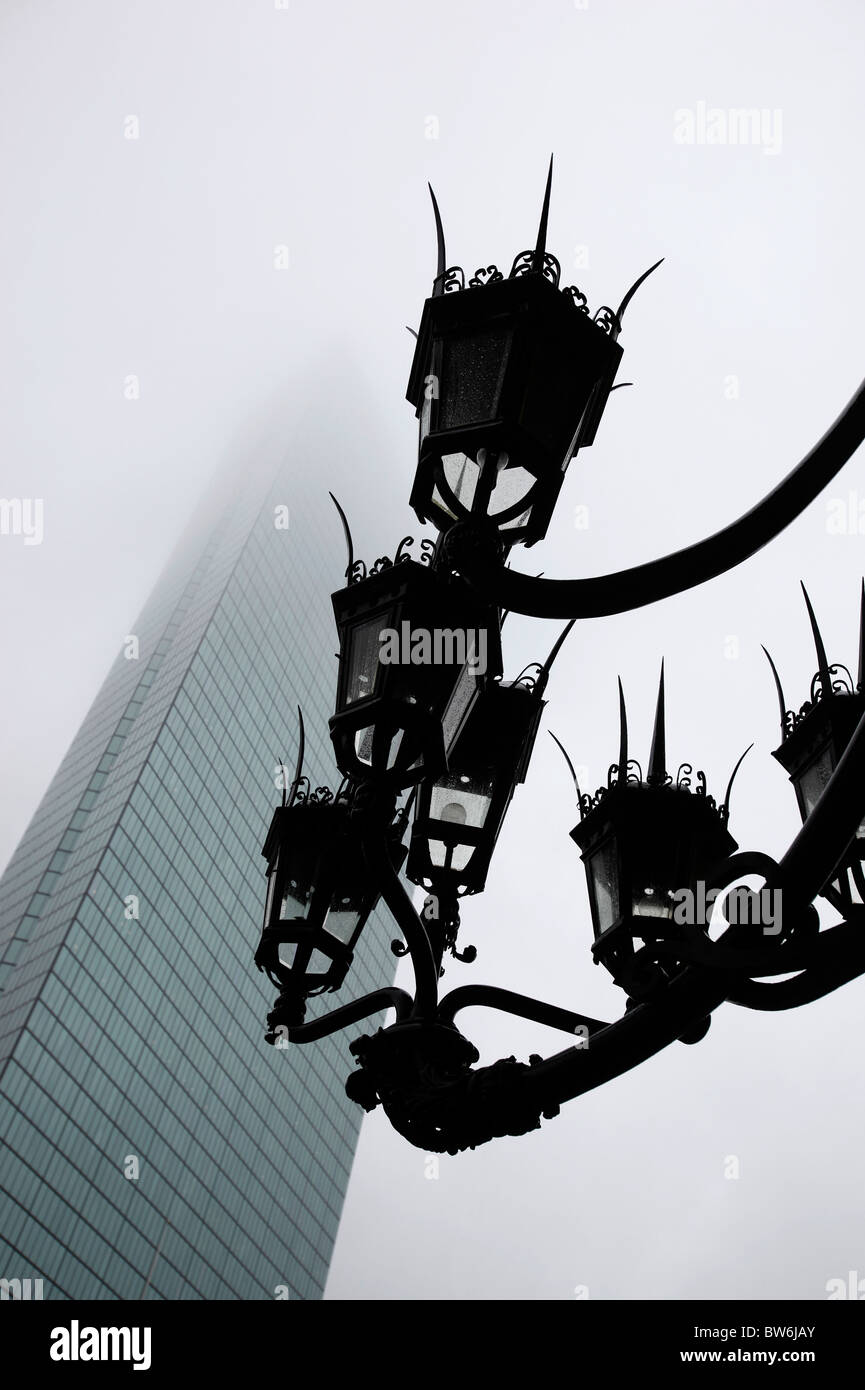 Ornate lamps and the John Hancock building in the fog, Boston Massachusetts - Stock Image