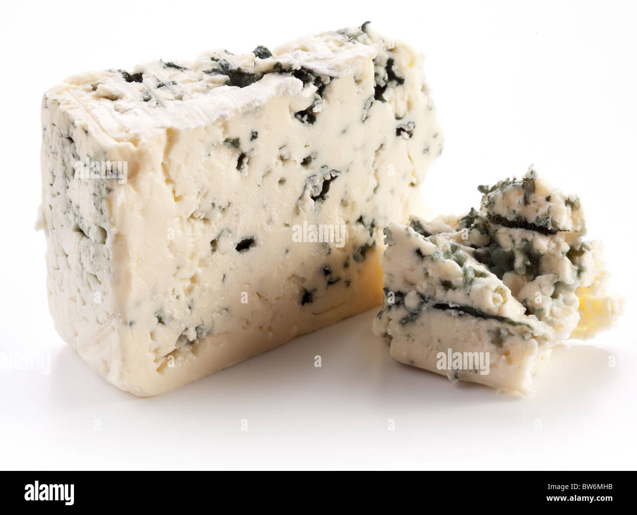 Blue cheese on a white background. - Stock Image