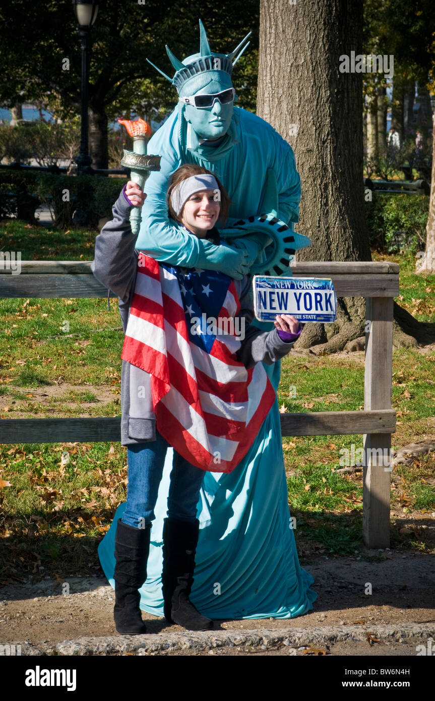 NYC Statue of Liberty  street performing mimes in city park. White face, faced.  Humor, kitsch. - Stock Image