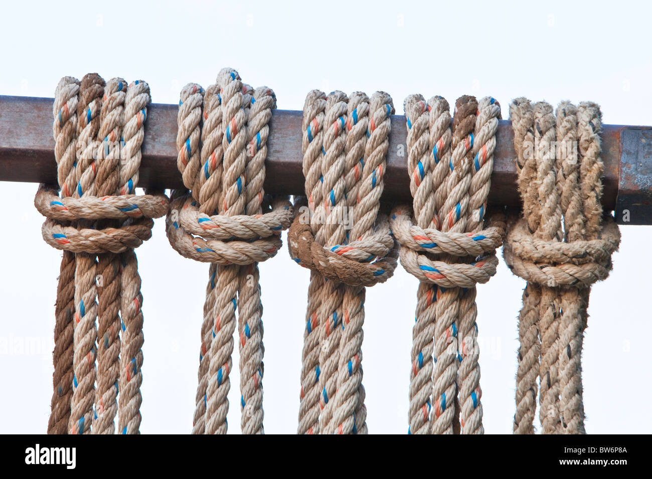 Reverse Lark's Head knots, color flecked rope. - Stock Image
