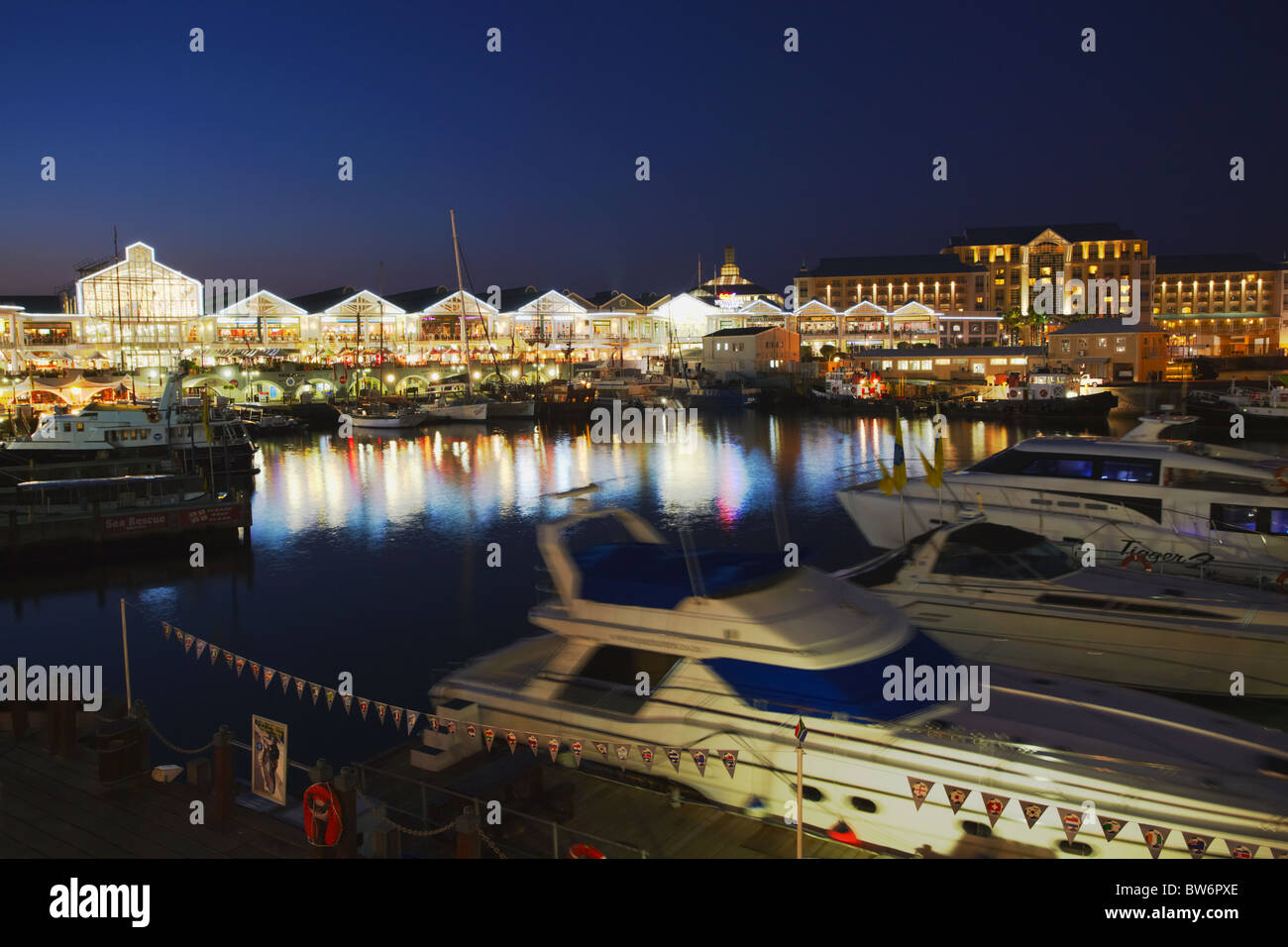 Victoria and Alfred Waterfront at dusk, Cape Town, Western Cape, South Africa - Stock Image