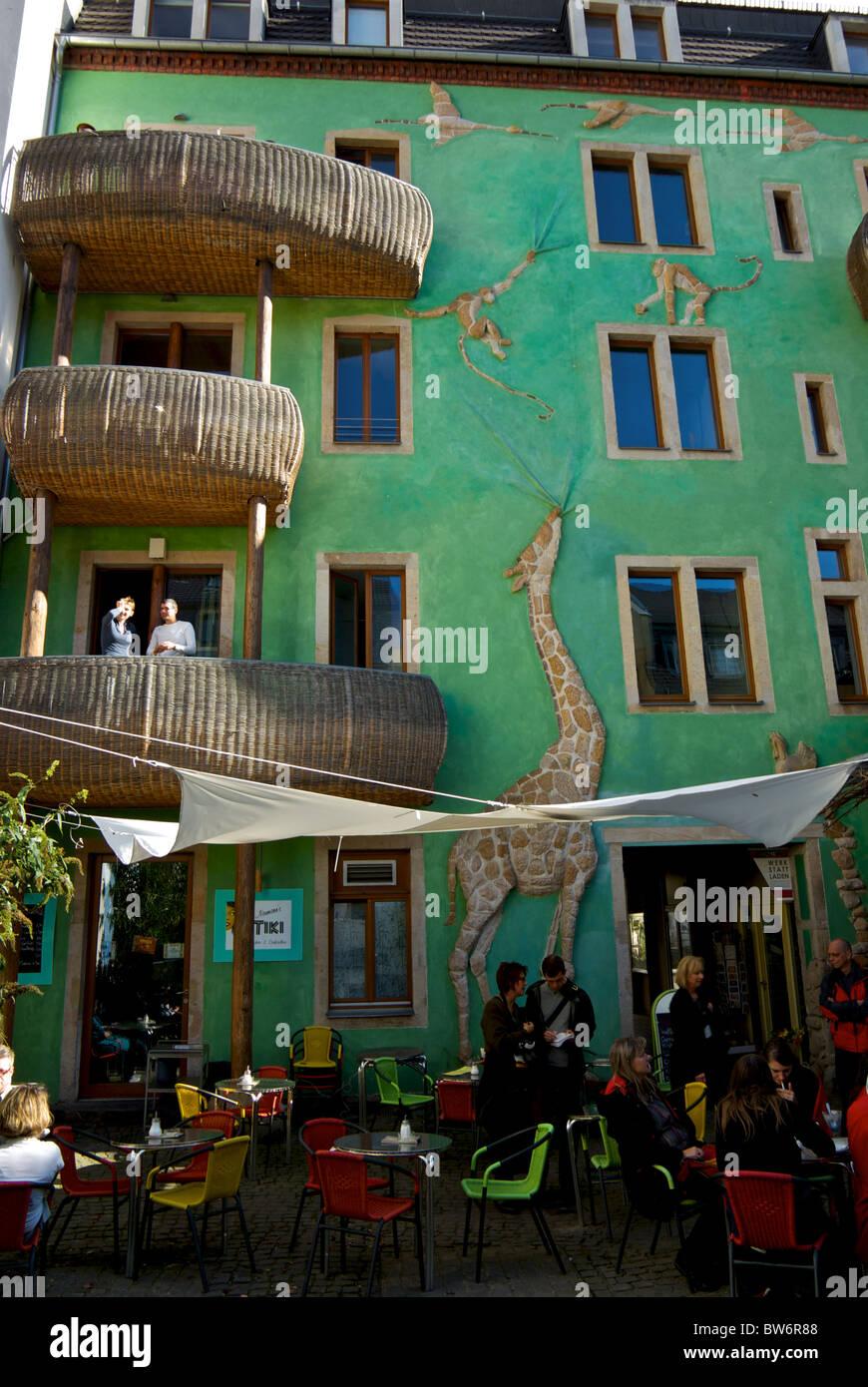 Wicker basket enclosed balconies pottery giraffe monkeys ibises Courtyard of Metamorphoses Dresden new town neustadt - Stock Image