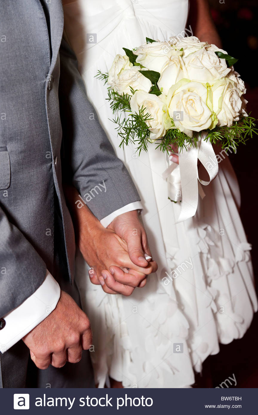 Bride and Groom getting married holding hands - Stock Image