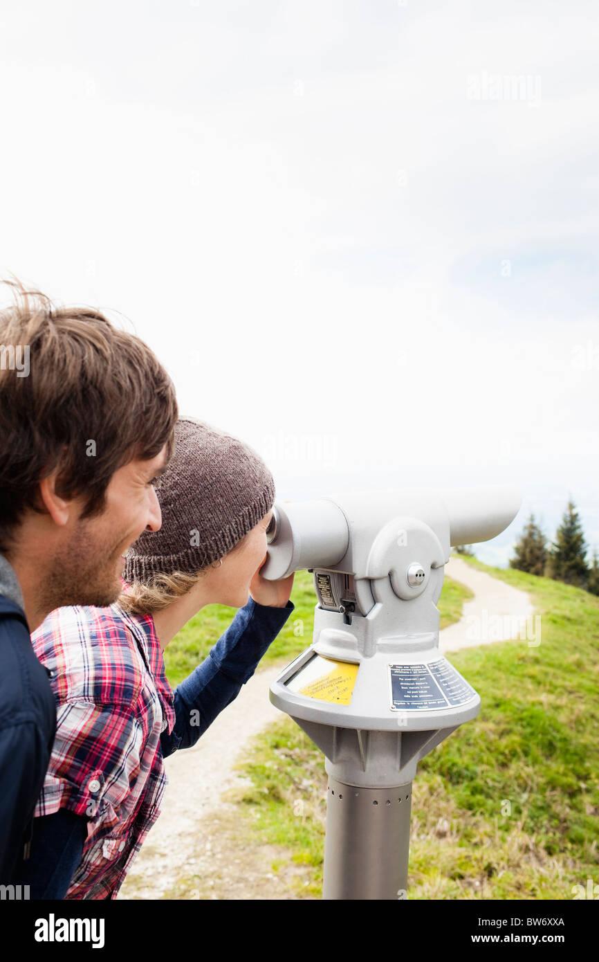 Couple using telescope - Stock Image
