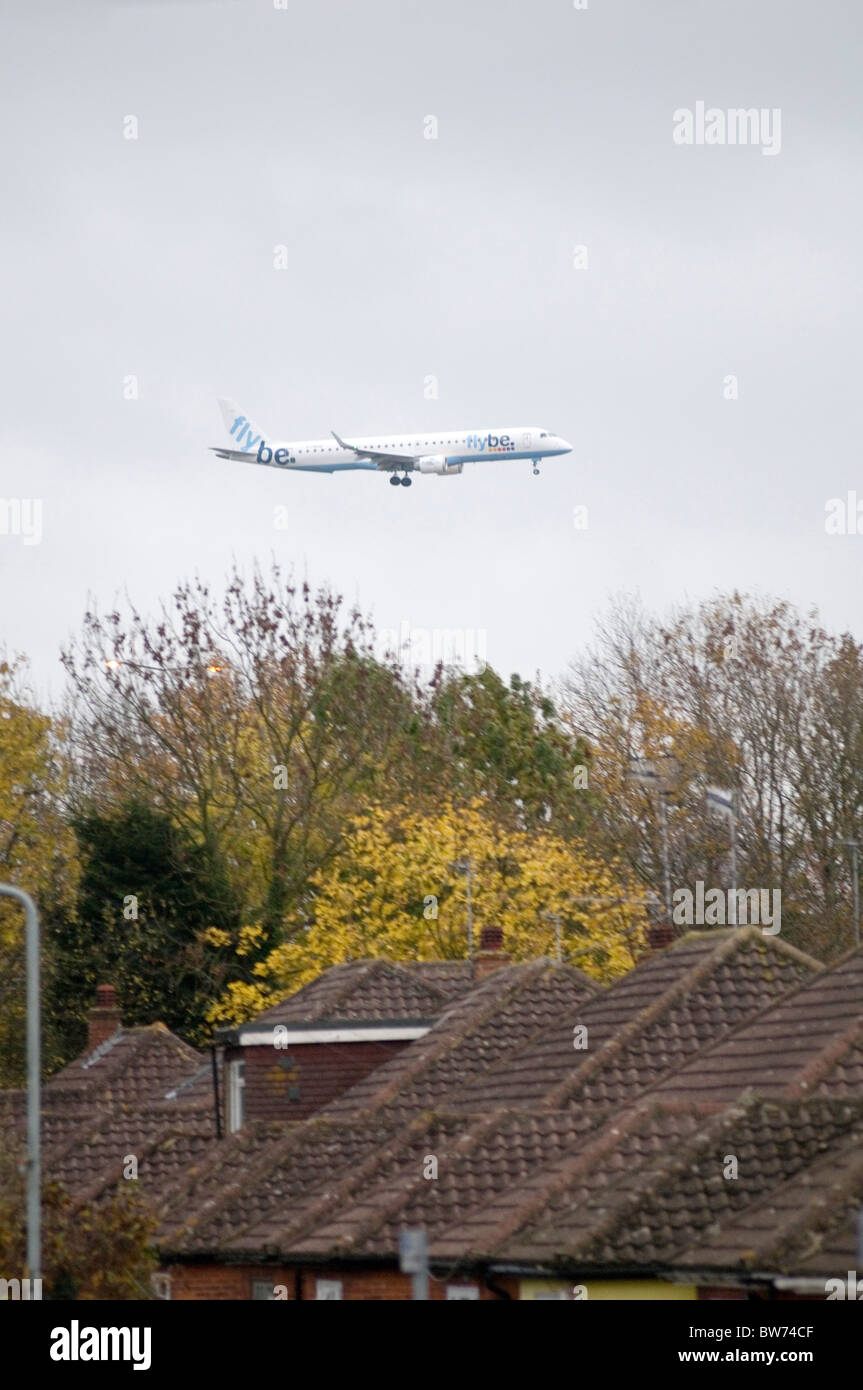 low flying aircraft near gatwick airport flightpath flight path living under near an busy planes plane airplane - Stock Image