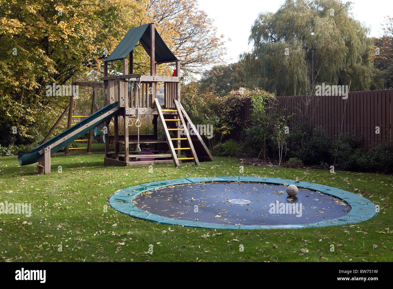 Exceptional Climbing Frame, Slide And Trampoline In Garden.