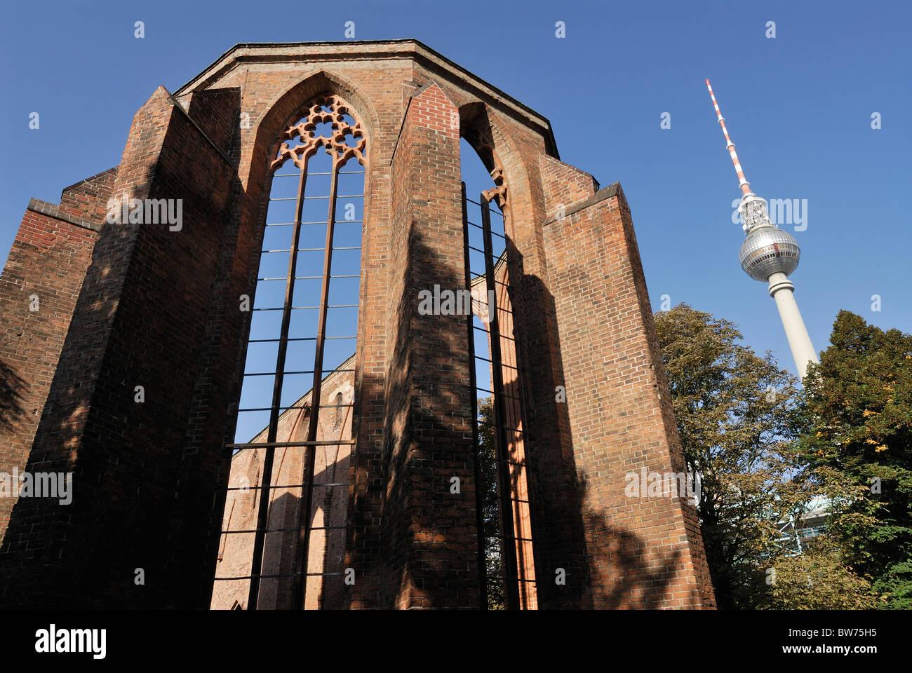 Berlin. Germany. Franziskaner Klosterkirche and Fernsehturm TV tower. - Stock Image