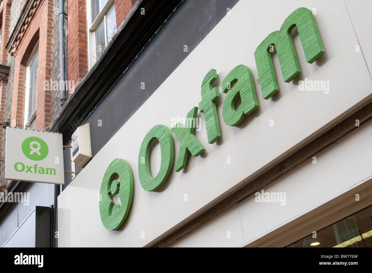oxfam charity shops shop secondhand second hand clothes retail retailer charities uk high street highstreet logo - Stock Image