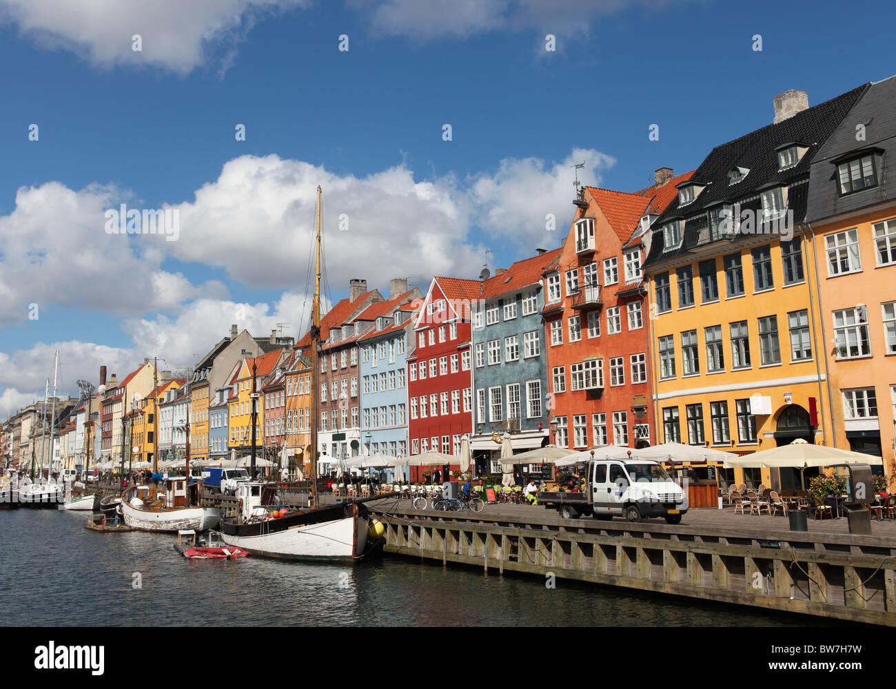 Nyhavn in Copenhagen, Denmark - one of the most popular tourist places - Stock Image