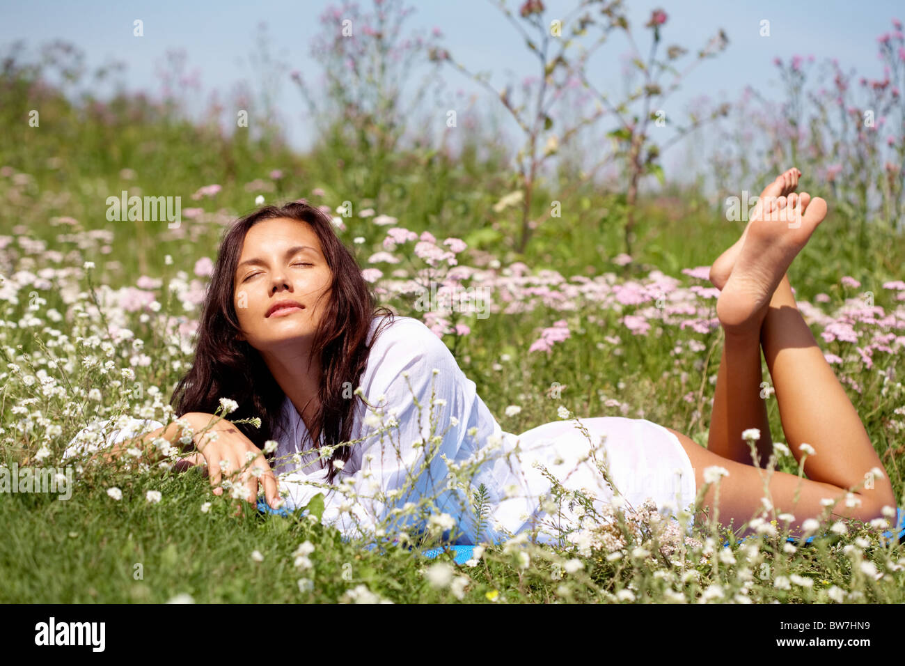 Portrait of pretty girl dreaming on the glade - Stock Image