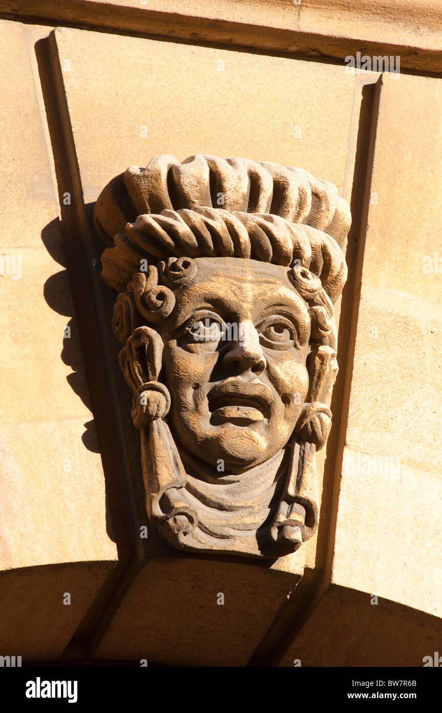 Carved head on side of the Sheldonian Theatre Oxford England UK. Stock Photo