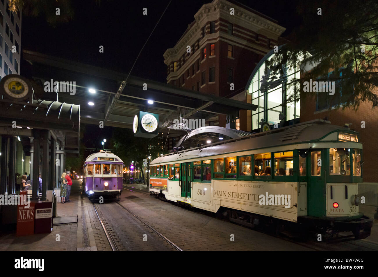 Main Street trolleys at night in Peabody Place, Main Street, Memphis, Tennessee, USA - Stock Image