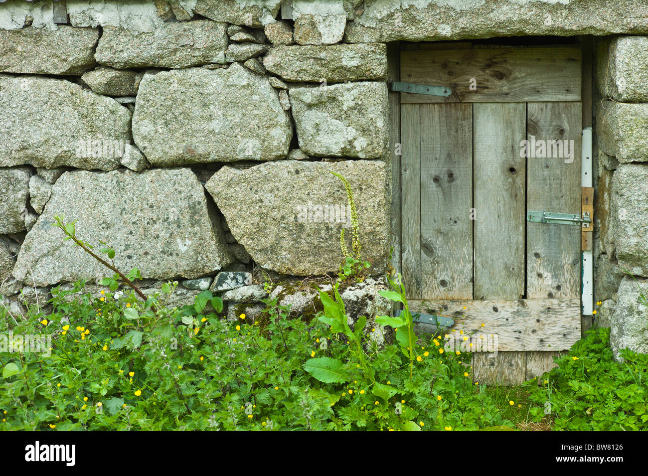 Old stone cottage with block stones at Rosmuch, Connemara, County Galway, Ireland - Stock Image