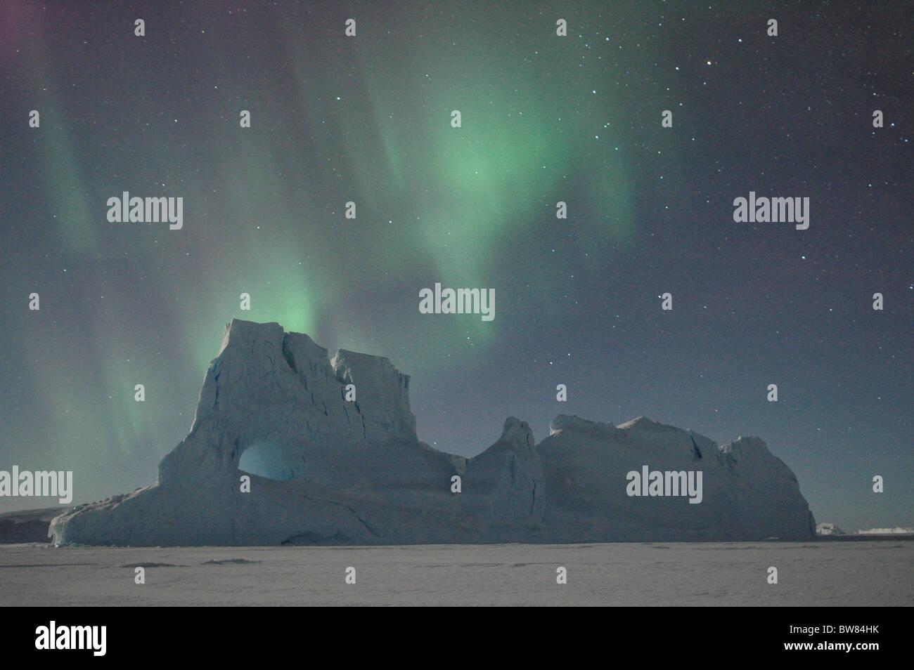 Southern lights, Aurora australis, over antarctic landscape, Antarctica - Stock Image