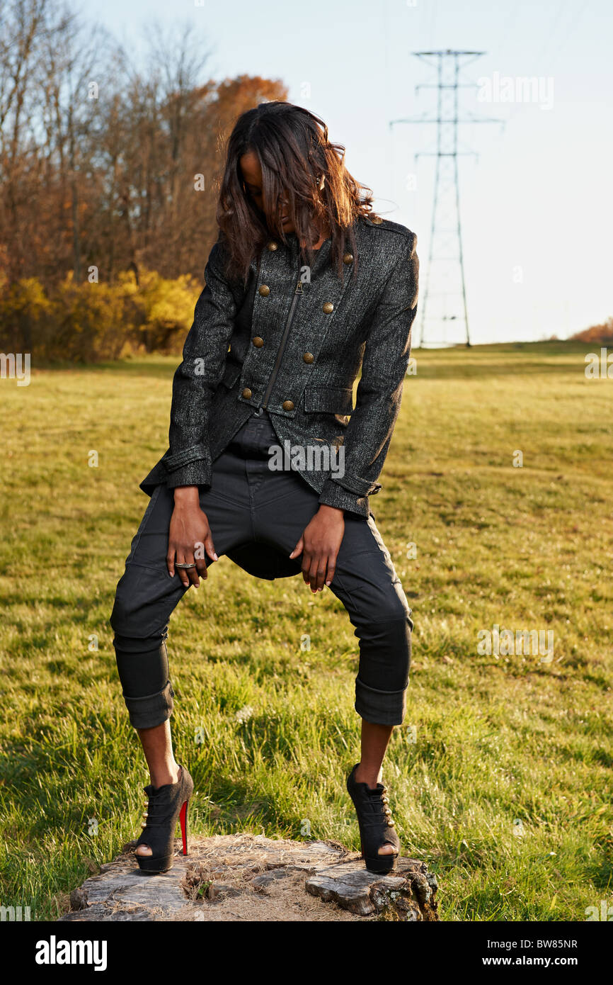 Depressed African-American Model Standing in front of Electrical Power Lines - Stock Image