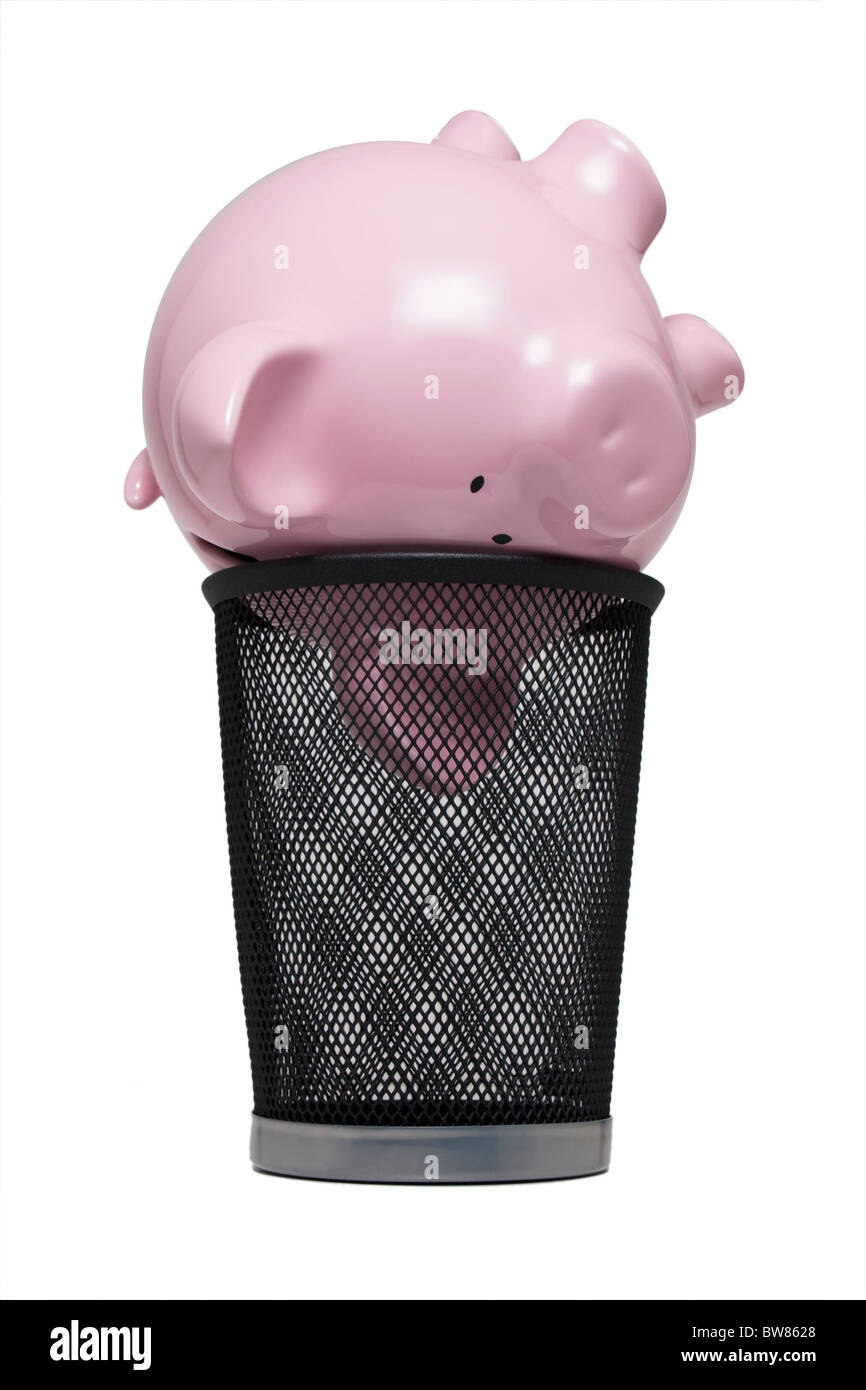 Piggy bank in a trash can - Stock Image